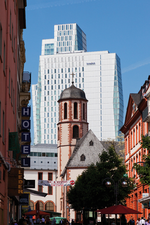 incidental people: Germany,Hesse,Frankfurt,View of Liebfrauenkirche church in front of Nextower