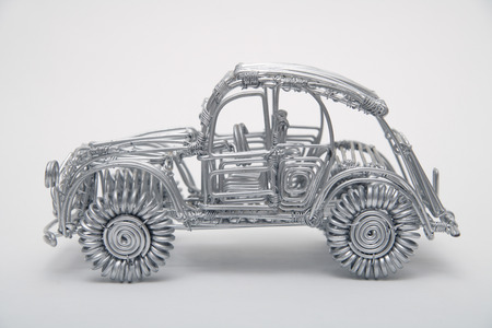 pliable: Toy car made of pliable wire against white background,close up