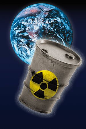 radioactivity: Barrel with signs of radioactivity in front of earth Stock Photo