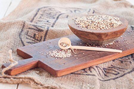 tricolour: Tricolor quinoa in wooden bowl, wooden spoon