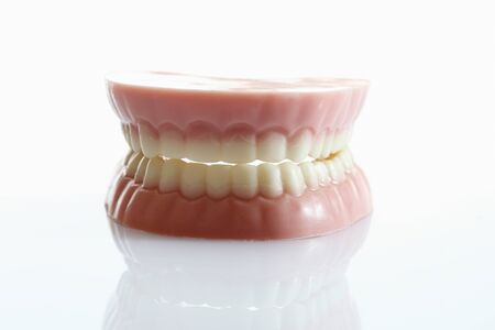 prophylaxis: Dentures made of sugar and white chocolate on white background,close up Stock Photo