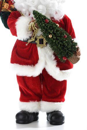 pere noel: Le Père Noël tenant arbre de Noël Banque d'images