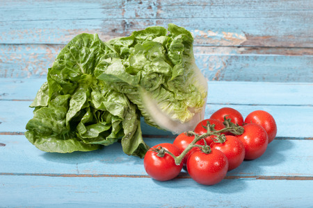 romaine: Close up of mini romaine lettuce and vine tomatoes Stock Photo