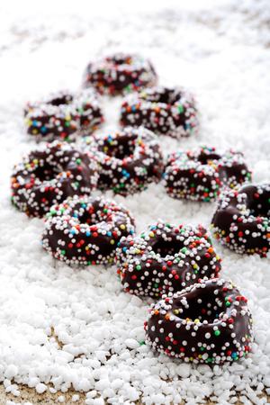 nibble: Chocolate fondant rings on icing sugar