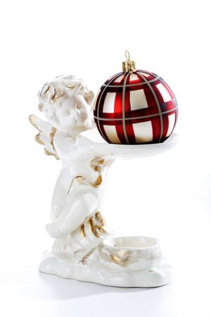 putto: Angel figurine holding Christmas bauble