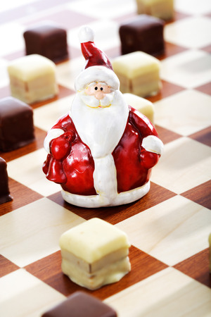 chocolate icing: Dominostein Christmas pastry  with chocolate icing on chess board