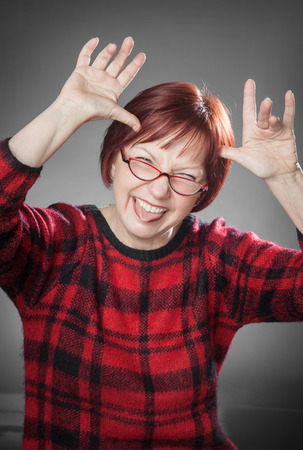 messing: Red-haired woman, portrait, messing around, sticking out the tongue