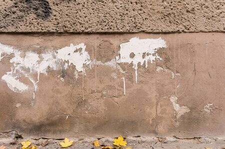 decayed: Decayed outside wall, brown foundation with white color splashes Stock Photo