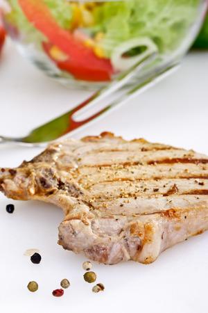 grilled pork chop: Grilled pork chop, peppercorns, meat fork