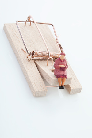 mouse trap: Figurine of woman pensioner on mouse trap