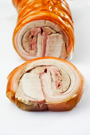 Slices of roasted rolled roast, suckling pig