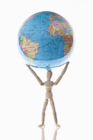 holding globe: Wood puppet holding globe