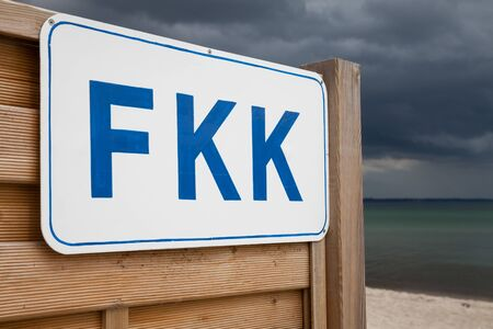nudism: Germany, Schleswig-Holstein, Baltic Sea, Sign FKK at beach Stock Photo
