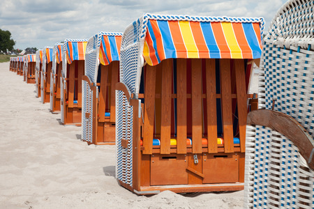 Germany, Schleswig-Holstein, Baltic Sea, closed beach chairs at beach Zdjęcie Seryjne
