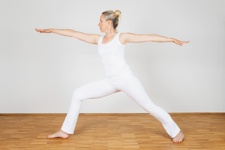 warrior pose: Woman praciticing yoga, Warrior Pose Stock Photo
