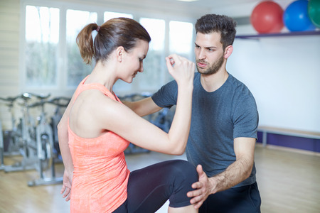 Couple training in fitness studio