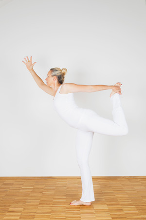 leisure wear: Woman praciticing yoga, Dancer Postition Stock Photo