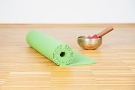 singing bowl: Yoga mat and singing bowl Stock Photo