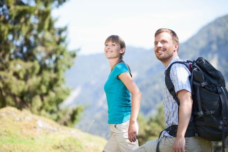 mid adult couple: Germany,Upper Bavaria,Couple hiking,smiling