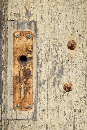 mounting: Rusty door mounting on wood