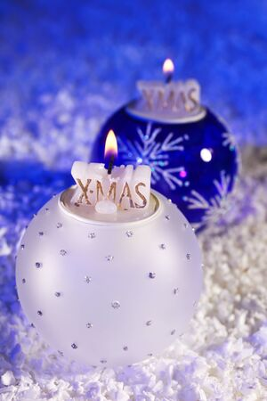 Baubles with candles, artificial snow, closeup on Christmas decoration Stock Photo