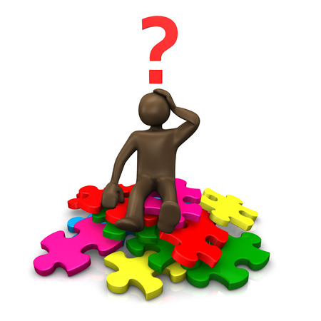 Brown figurine sitting on pieces of puzzle, asking Stock Photo