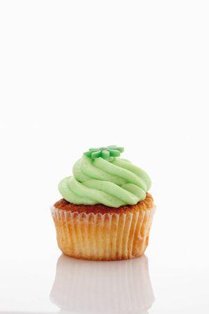 woodruff: Close up of buttercream woodruff cupcake against white background Stock Photo