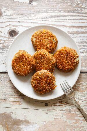 spelt: Vegetarian spelt patties with carrot on plate Stock Photo