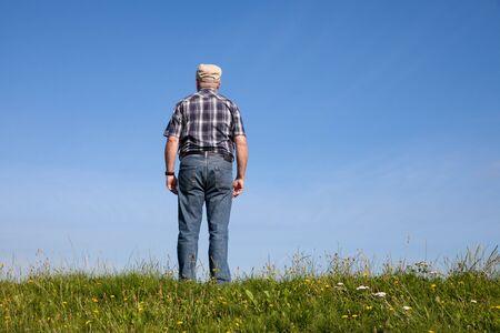 saxony: Germany, Lower Saxony, man standing on dyke
