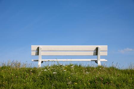 dyke: Germany, Lower Saxony, empty bench on dyke