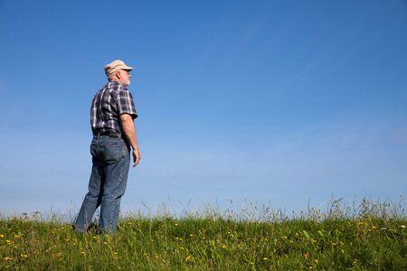 dyke: Germany, Lower Saxony, man standing on dyke