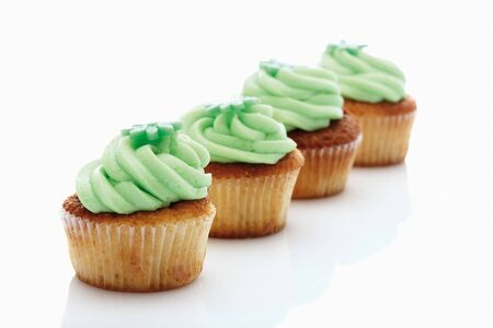 hundreds and thousands: Close up of buttercream woodruff cupcake against white background Stock Photo