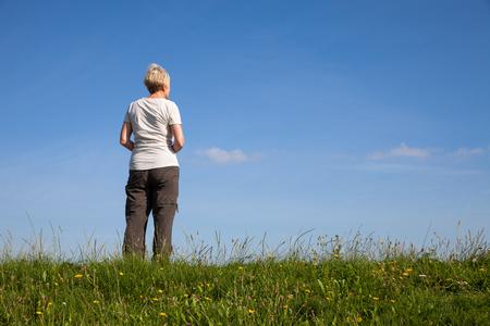 dyke: Germany, Lower Saxony, woman standing on dyke