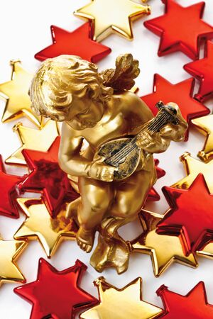 putto: Golden putto on golden and red stars