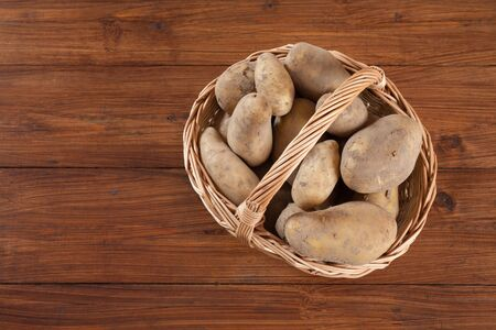 copy  space: Basket with potatoes, copy space Stock Photo
