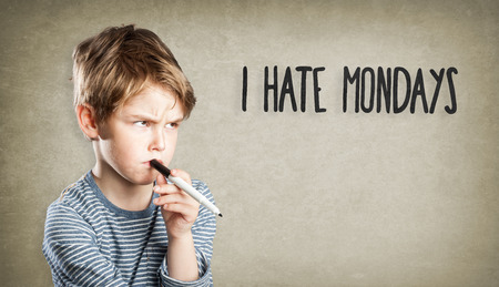 mondays: Boy on grunge background, I hate mondays Stock Photo