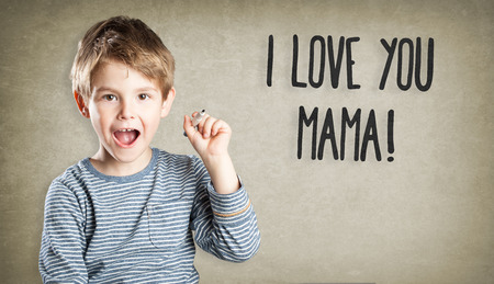 mothersday: Boy writing I love you mama for mothersday Stock Photo