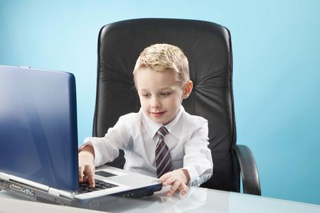 Prodigy: boy using laptop Zdjęcie Seryjne