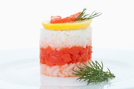 coalfish: Rice tart garnished with lemon slice and dill in plate Stock Photo