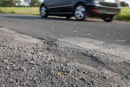 pothole: Germany, car on road, apshalt, pothole