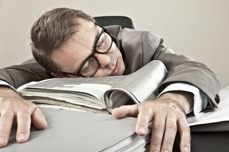 overstress: Close up of mature businessman lying on office file