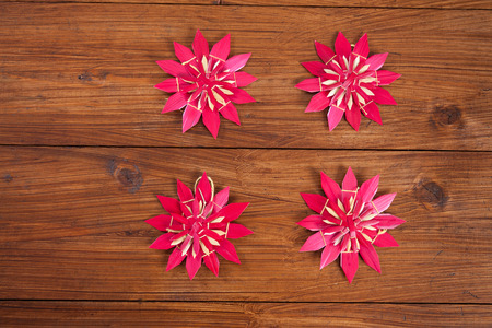 christmastime: Christmas decoration on wood, red straw stars, copy space