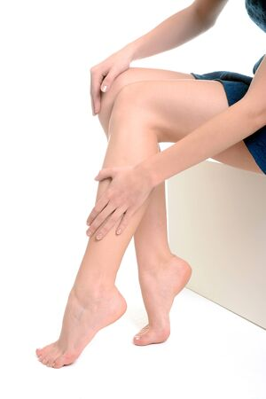 barefooted: Womans legs, pain Stock Photo