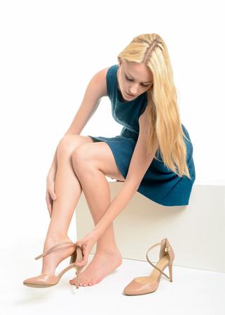 women undressing: Young blonde woman, high heels