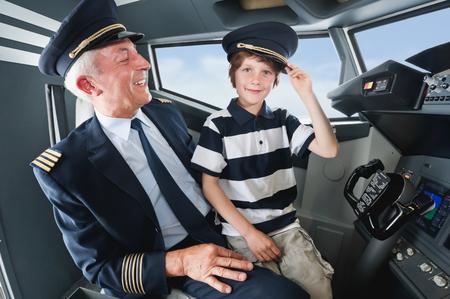 pilot cockpit: Germany,Bavaria,Munich,Senior pilot and boy in airplane cockpit Stock Photo