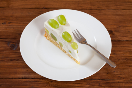 torte: Piece of grape torte with green grapes on plate