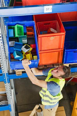 warehouseman: Germany,Bavaria,Munich,Manual worker working in warehouse