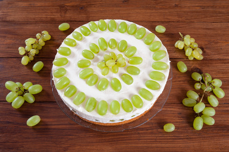 torte: Grape torte with green grapes on cake plate