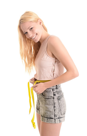 girth: Young blonde woman measuring abdominal girth