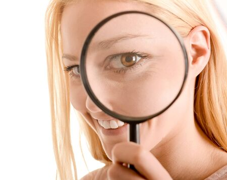 exactitude: Woman with magnifier Stock Photo